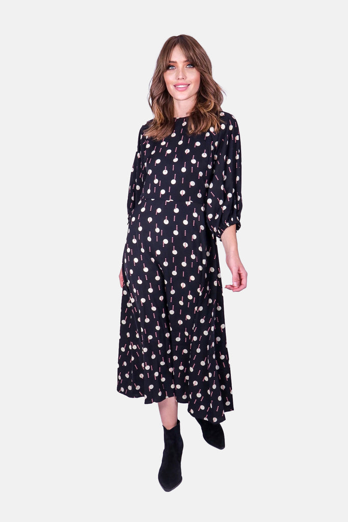 Traffic People Drape Printed Long Sleeve Midi Dress in Black and White Front View Image
