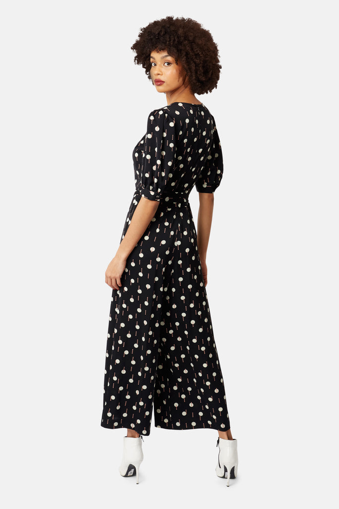 Traffic People Geometric Print V-Neck Hetty Jumpsuit in Black and White Side View Image