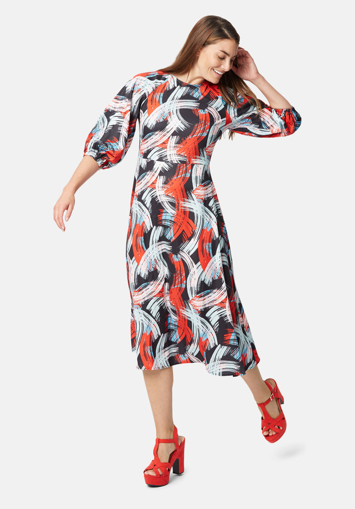 Traffic People Graphic Printed Midi Drap Dress in Red and Black Front View Image