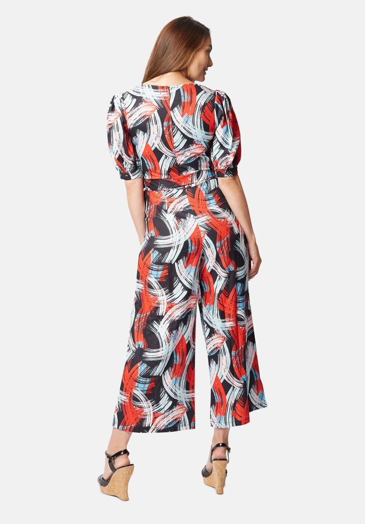 Traffic People Printed V-Neck Betty Jumpsuit in Red and Black Side View Image