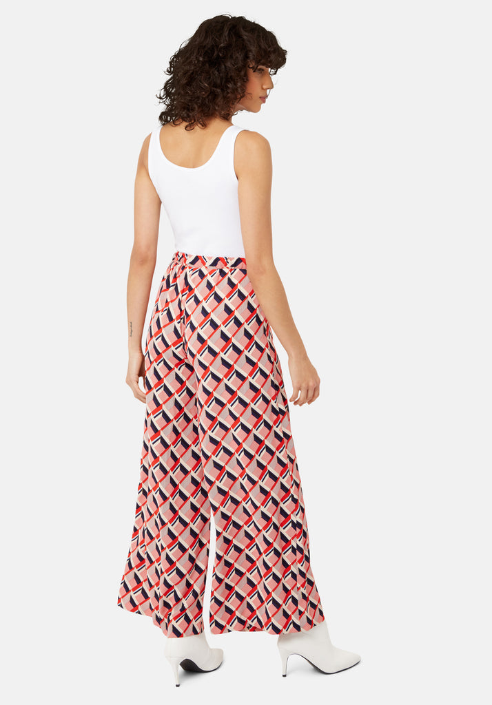 Traffic People Just Keep Staring Wide Leg Trouser in Red Geometric Print Side View Image