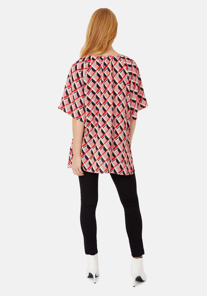 Traffic People Just Keep Staring V-neck Tunic in Red and Beige Side View Image