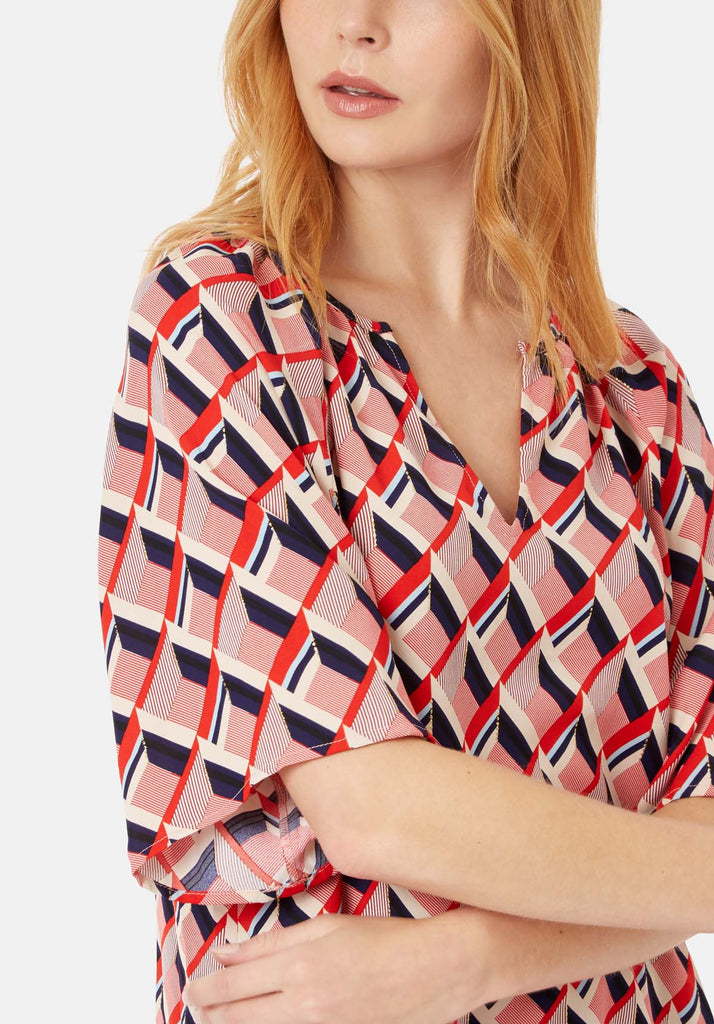 Traffic People Just Keep Staring V-neck Tunic in Red and Beige Close Up Image