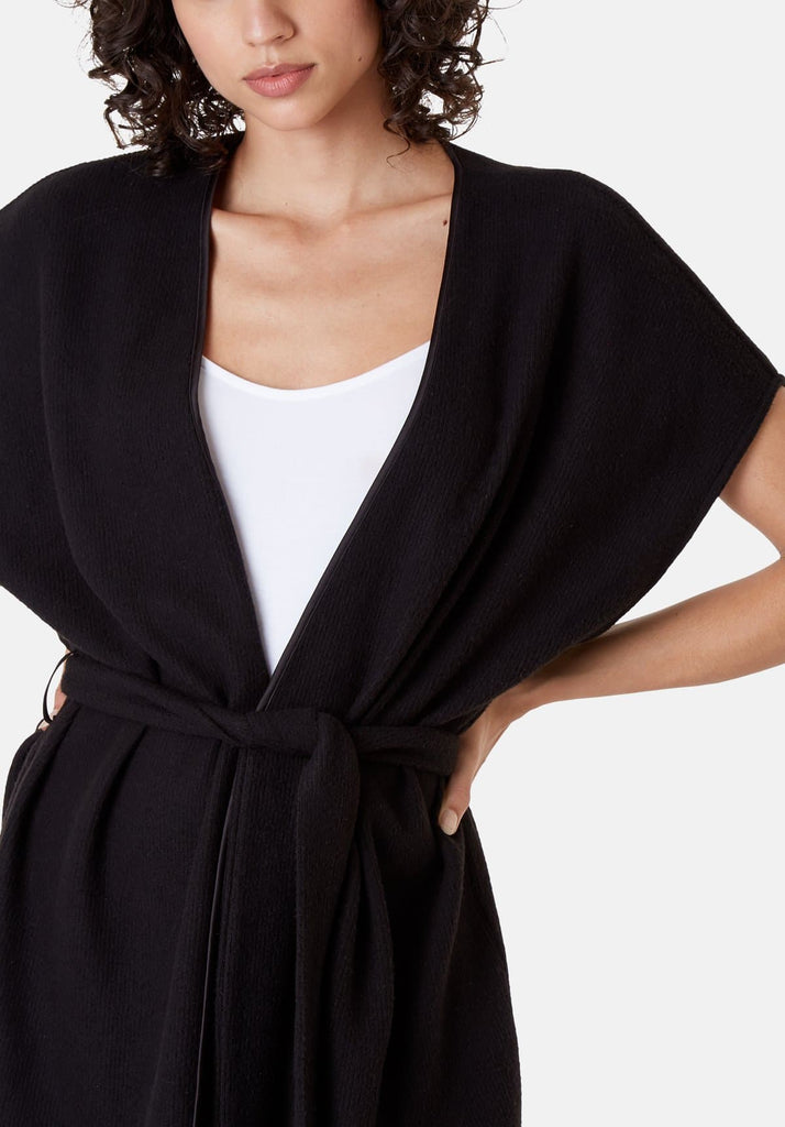 Traffic People Poncho Sleeveless Wrap Cardigan in Black Close Up Image