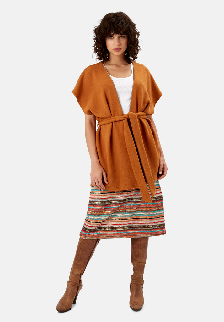 Traffic People Poncho Sleeveless Wrap Cardigan in Rust Brown Front View Image