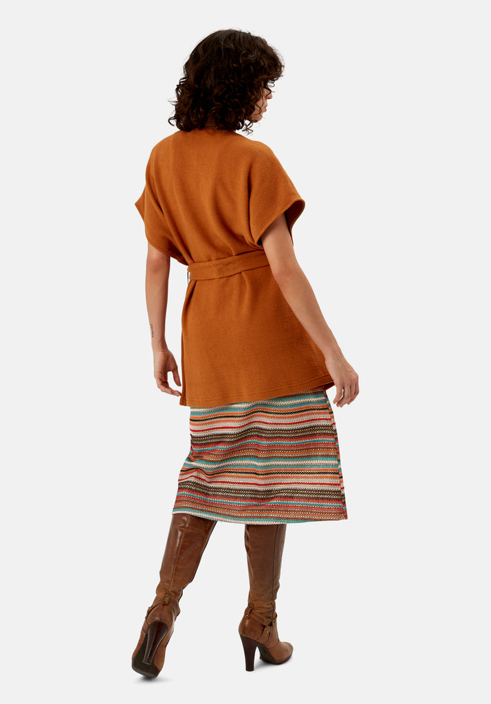 Traffic People Poncho Sleeveless Wrap Cardigan in Rust Brown Back View Image