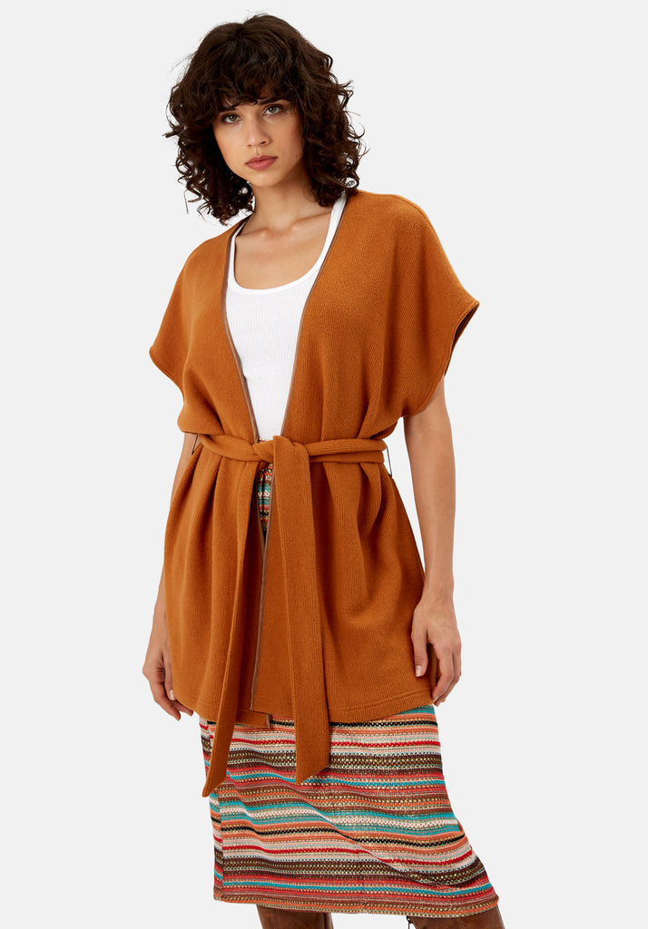 Traffic People Poncho Sleeveless Wrap Cardigan in Rust Brown Side View Image