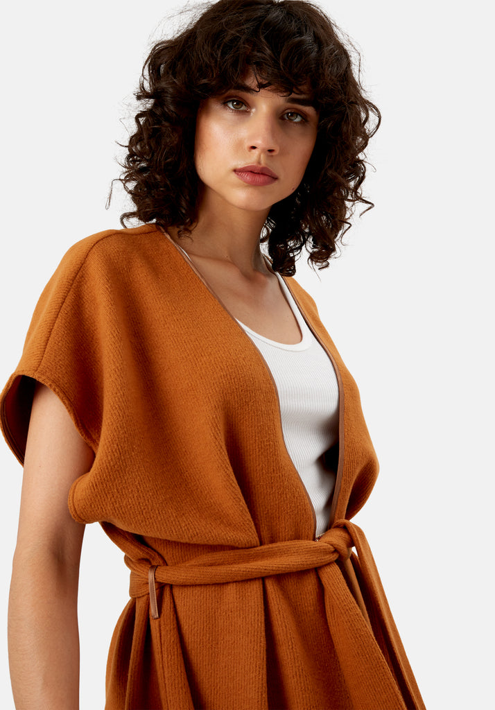 Traffic People Poncho Sleeveless Wrap Cardigan in Rust Brown Close Up Image