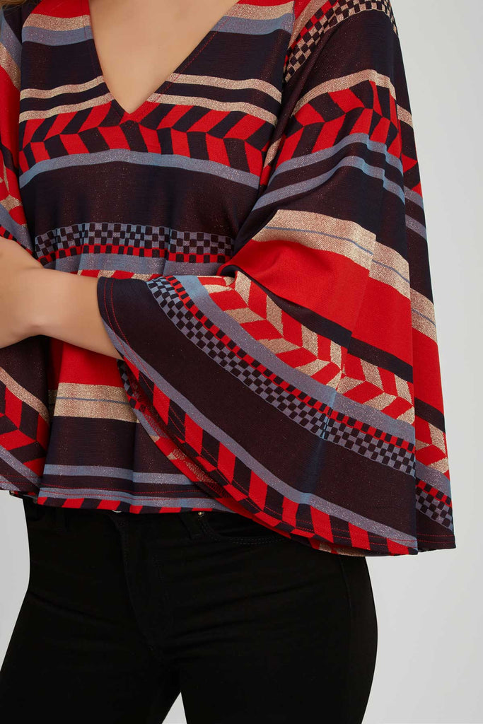 Traffic People Vanquish Geometric Top in Red Close Up Image