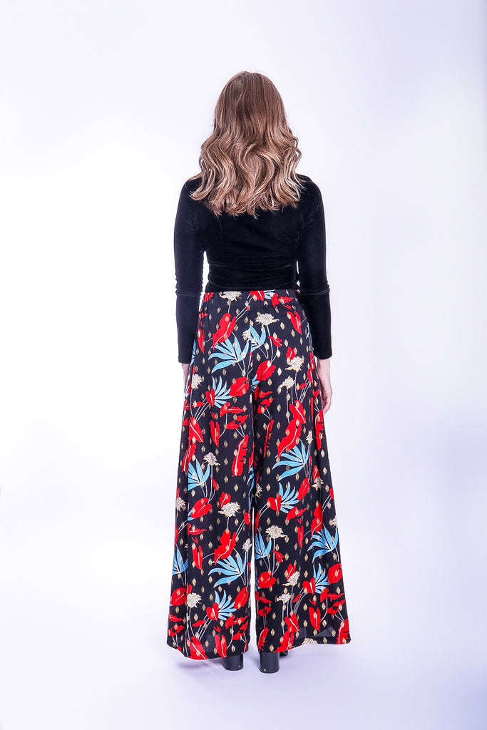 Traffic People Mustique Maggie Wide Leg Palazzo Trousers in Floral Print Close Up Image