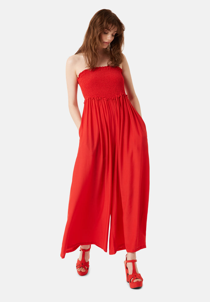 Traffic People Strapless Wide Leg Smock Jumpsuit in Red Front View Image