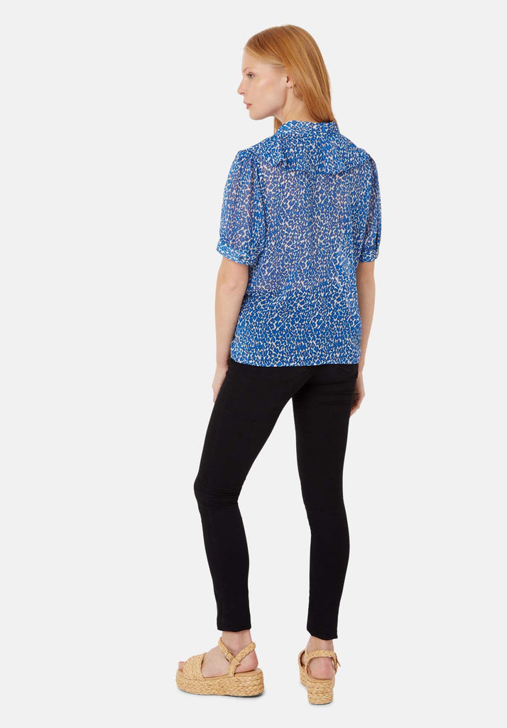 Traffic People Ruffle Animal Print Short Sleeve Blouse in Blue Side View Image