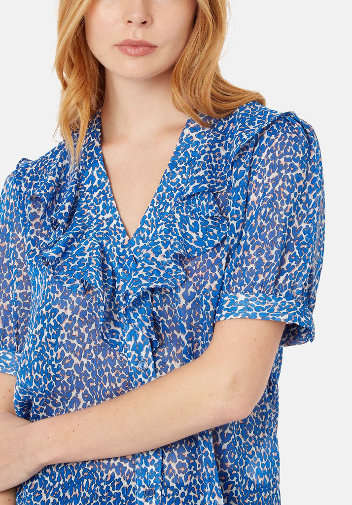 Traffic People Ruffle Animal Print Short Sleeve Blouse in Blue Close Up Image