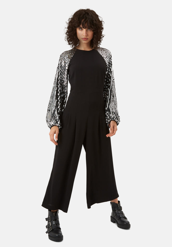 Traffic People Shoulder The Blame Wide Leg Sequin Jumpsuit in Black Front View Image