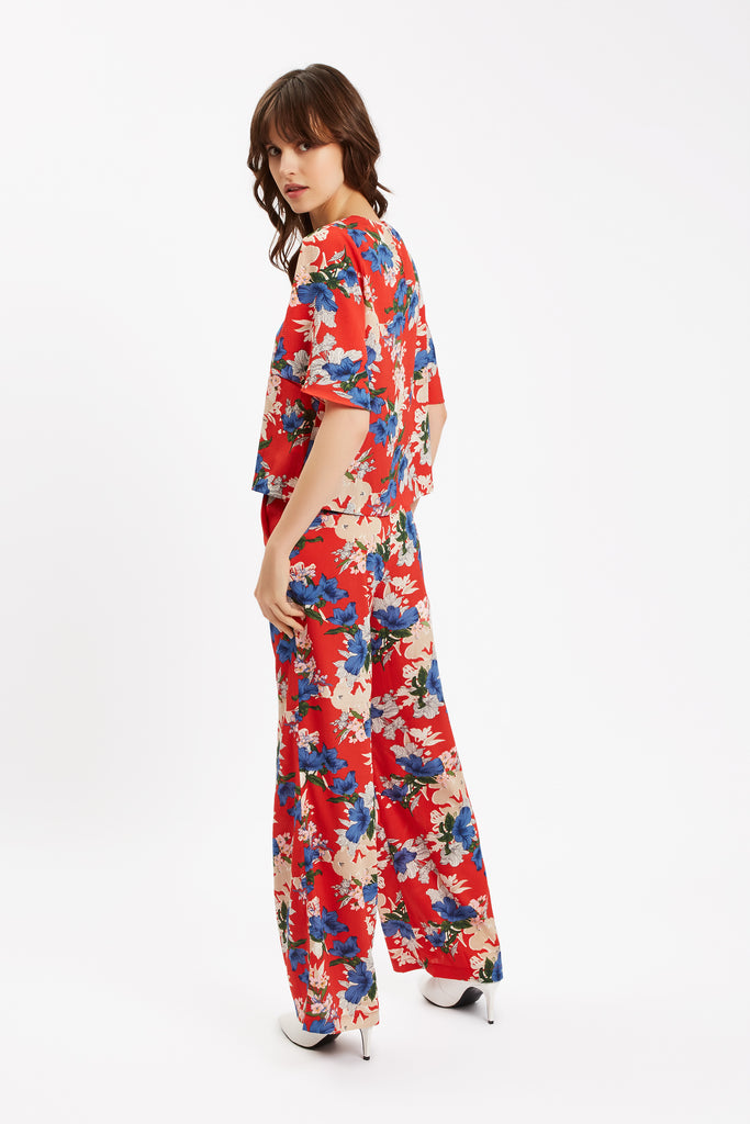 Traffic People SING Floral Red Wide Leg Trousers Close Up Image
