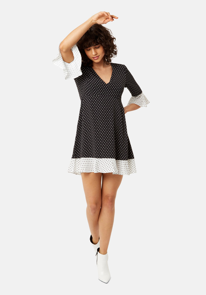 Traffic People Frill Star Print Mini Dress in Black and White Front View Image