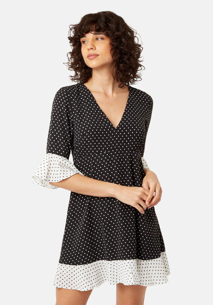Traffic People Frill Star Print Mini Dress in Black and White Back View Image