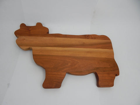 Cow shaped cutting boards. Solid Walnut, Cherry or Maple woods.