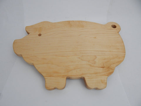 Pig shaped cutting boards. Solid Walnut, Cherry or Maple woods.
