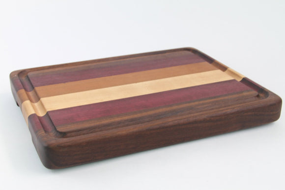 Handcrafted Wood Cutting Board - Edge Grain - Walnut, Cherry, Purpleheart & Maple. Juice groove, no slip bottom and easy grip. For chef/cook