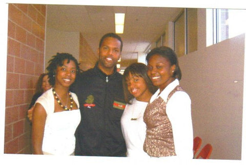 Bliss with the AJ of BET's 106 & Park show after singing before his keynote speech at East Orange Campus High School