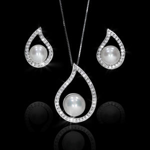 Set de Perla con Diamante 0.48 quilates Oro 14K