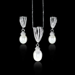 Set de Perla con Diamante 0.45 quilates Oro 14K