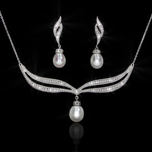 Set de Perla con Diamante 0.37 quilates Oro 14K
