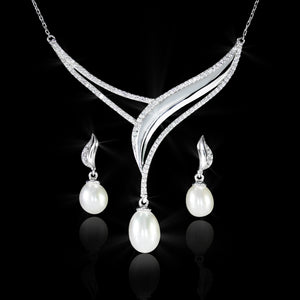 Set de Perla con Diamante 0.65 quilates Oro 14K