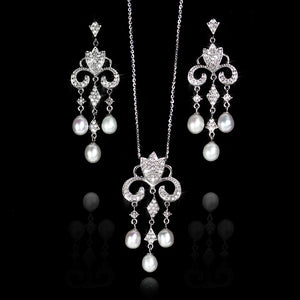 Set de Perla con Diamante 0.78 quilates Oro 14K