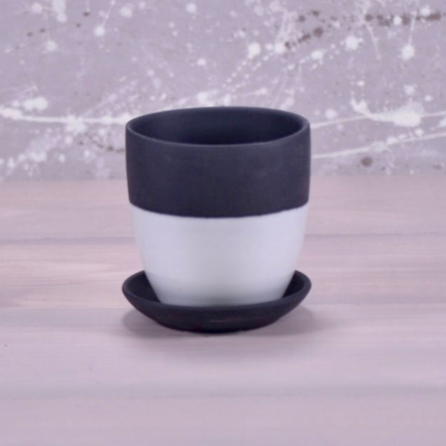 Dyad pot and saucer