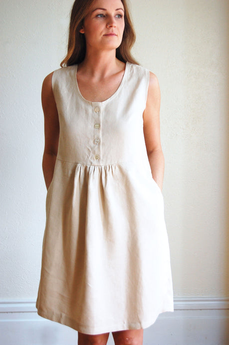 natural linen dress with gathered waist, button front, sleeveless and knee length