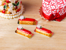 Load image into Gallery viewer, Snowflake and Red Iced French Christmas Eclair - Miniature Food
