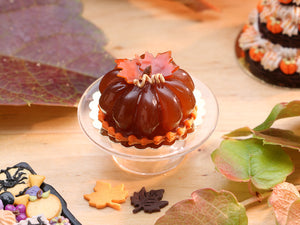 Pumpkin-Shaped Caramel Dessert Decorated with Autumn Leaves