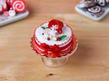Load image into Gallery viewer, Christmas Cake with Snowflakes Spilling from Cup - 12th Scale Miniature Food