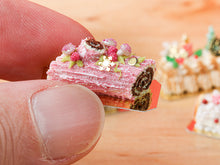 Load image into Gallery viewer, Traditional Chocolate and Raspberry Pink Yule Log / Bûche de Noël - Miniature Food in 12th Scale