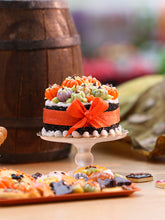 Load image into Gallery viewer, Miniature Cake Decorated with Coloured Pumpkins (Violet, Green Orange) - 12th Scale Miniature Food