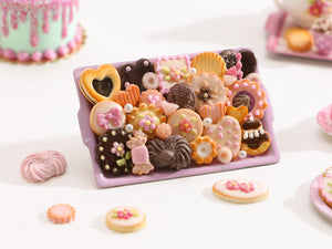 Unique Assortment of Pink & Chocolate Miniature Treats on Metal Baking Tray