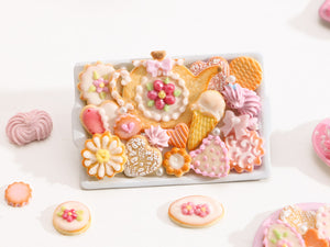 Unique Assortment of Summery Pink-Themed Sweet Miniature Treats on Tray