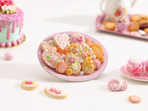 Assortment of Pink-Themed Sweet Miniature Treats on Oval Tray