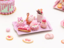 Load image into Gallery viewer, Beautiful presentation of pink miniature French pastries and treats (swan, éclair, religieuse)