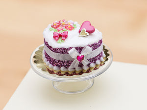 Handmade miniature heart-shaped Valentines Day cake in pink by Paris Miniatures