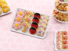 Load image into Gallery viewer, Spring-Themed Cookies on Baking Tray - Pink Sakura Spring Blossom, Tree Blossom, Ladybird, Sugared Violet Flower