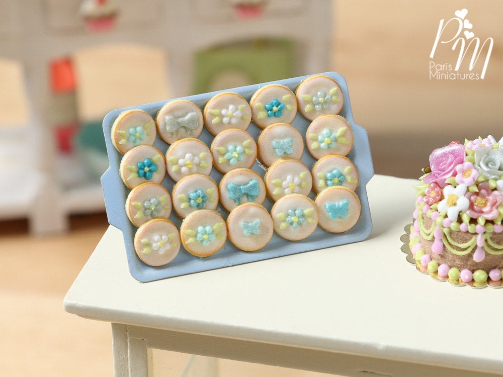 Presentation of Turquoise Decorated Cookies on Light Blue Baking Tray - Miniature Food