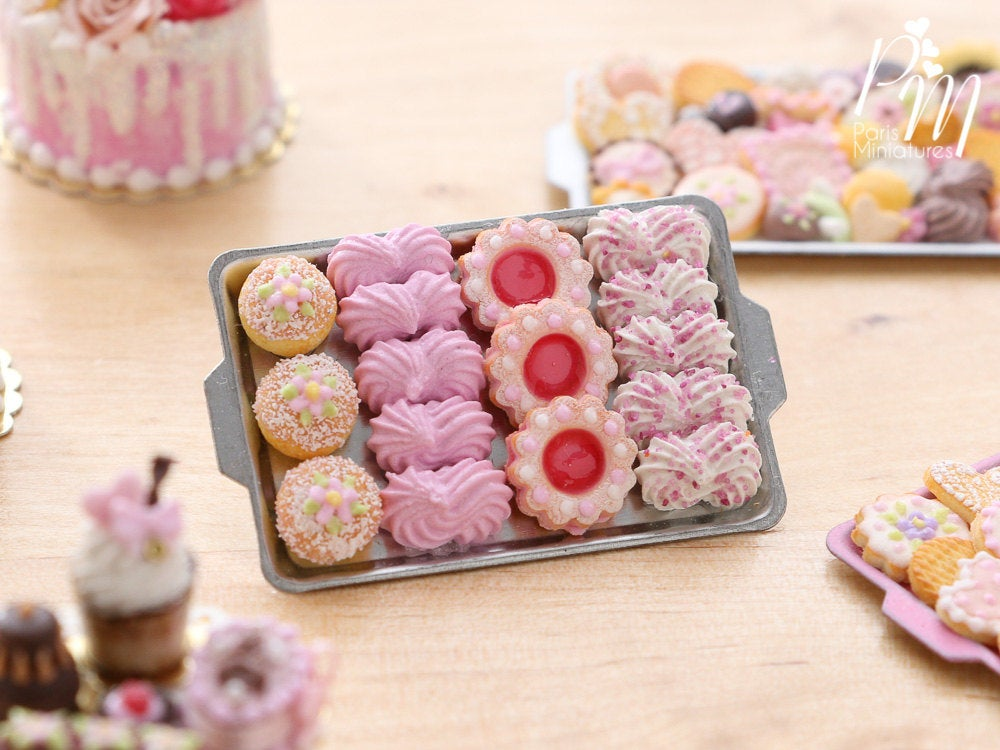 A miniature metal tray filled with handmade miniature food sweet treats including meringues in pink made from polymer clay