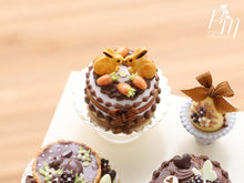 Load image into Gallery viewer, Chocolate Easter Cake Decorated with Bunny Cookies and Candy Egg 'Carrots' - Miniature Food