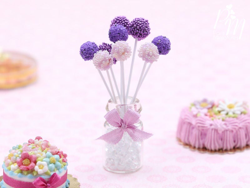 Purple and Pink Cake Pops Presented in a Glass Display Jar