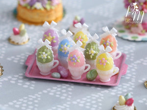 Handmade Miniature Presentation of Colourful Easter Eggs in Cups on Pink Metal Tray
