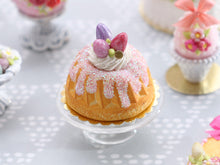Load image into Gallery viewer, Easter Kouglof decorated with pink egg meringue nest and sparkly frosting