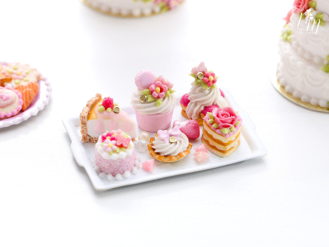 Beautiful presentation of pink pastries and treats (cheesecake slice, St Honoré...) - Miniature Food